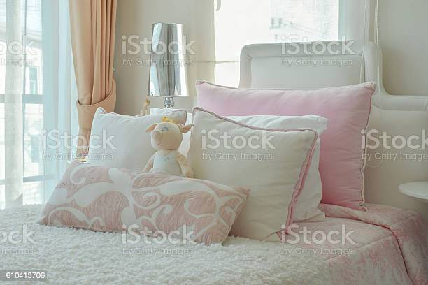 Pink and beige pillows on bed next to window picture id610413706?b=1&k=6&m=610413706&s=612x612&h=qt7jif1dnuob2gc7qtwpjk4qty8jdlt3 dt0aeaucrm=