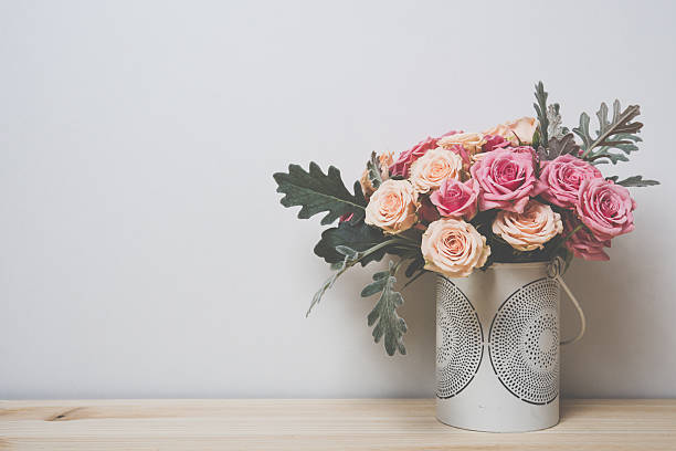 pink and beige roses stock photo - Flowers In Vase