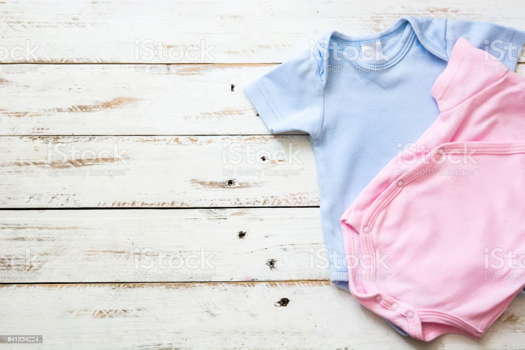 Pink and blue baby romper stock photo