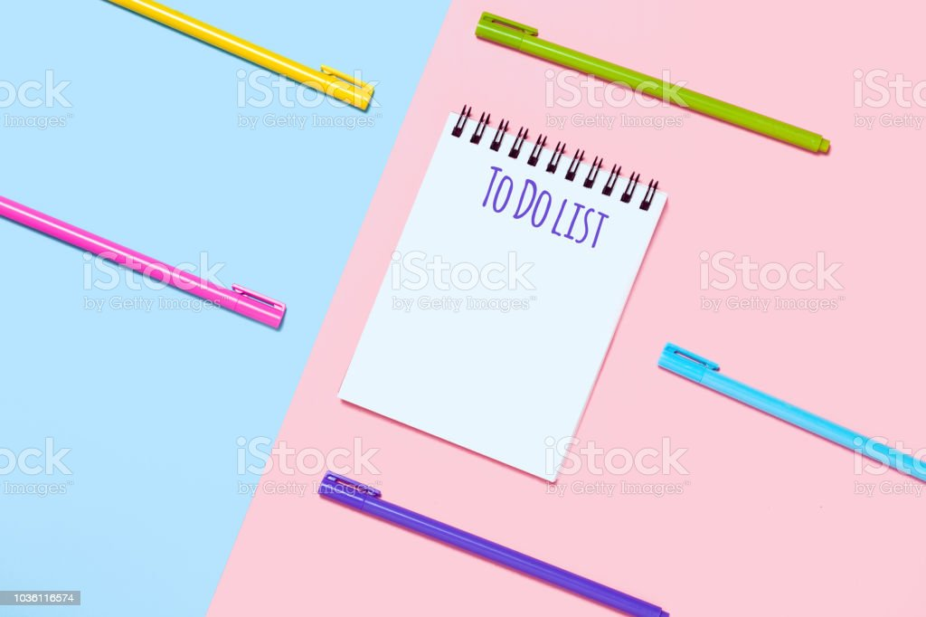 Pink and blue background with colorful pens. Minimalist stationary...