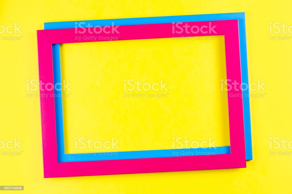 Pink and blue color frame on bright yellow background. stock photo