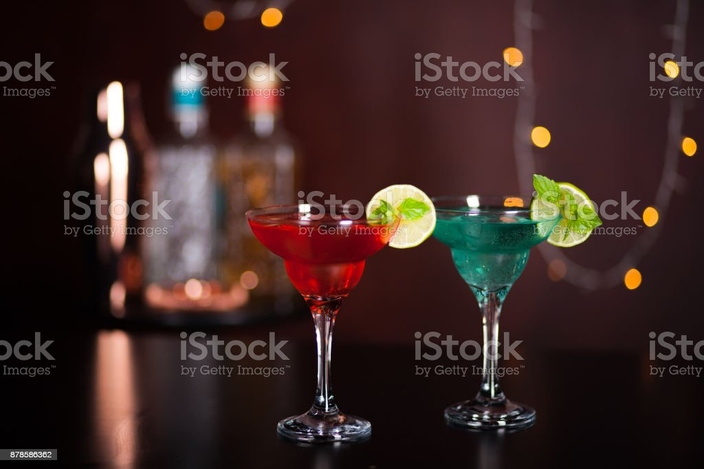 Pink and blue martini cocktails on the bar background. Alcoholic cocktails in the bar. stock photo
