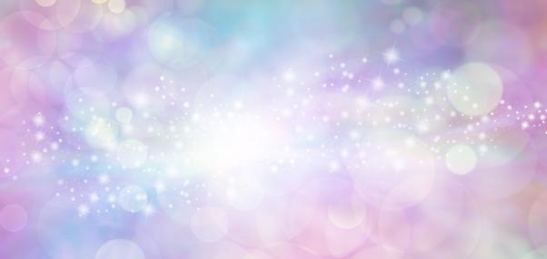 istock Pink and blue starry glitter feminine toned bokeh background banner 687566700