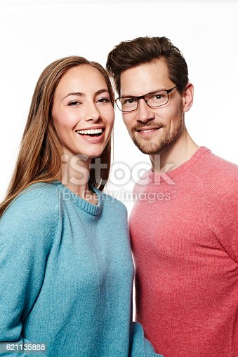 621502402 istock photo Pink and blue sweaters on couple, portrait 621135888