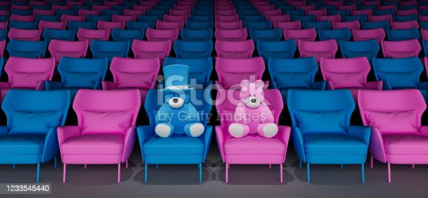 istock Pink and blue teddy bear sitting on armchair in theater. Watching movies concept 3d render 1233545440