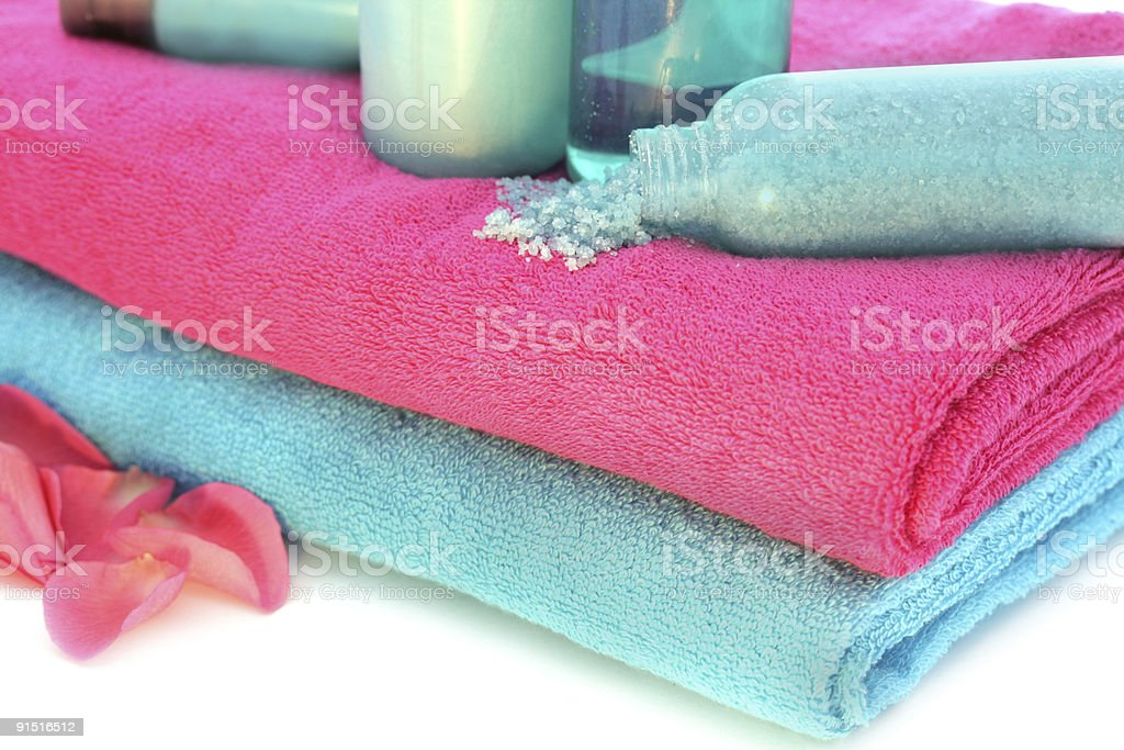 Pink and blue towels with shampoo, salt, body lotion stock photo