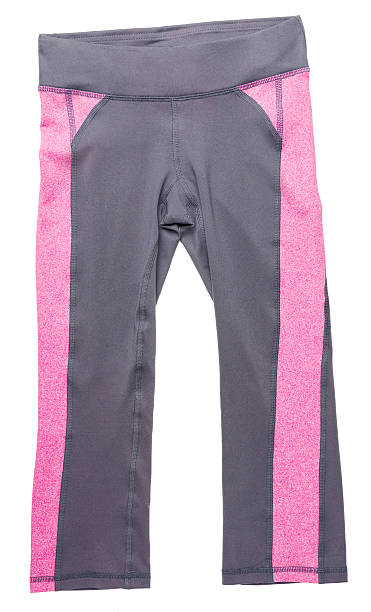 Pink and gray women's athletic pants on white stock photo