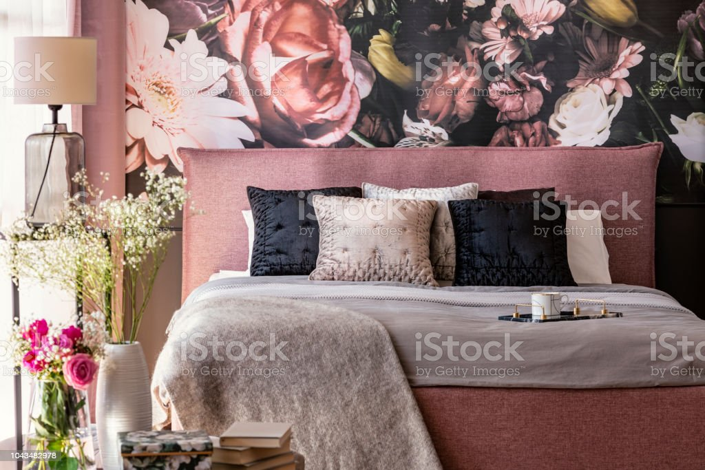 Pink And Grey Bed With Cushions In Patterned Bedroom ...