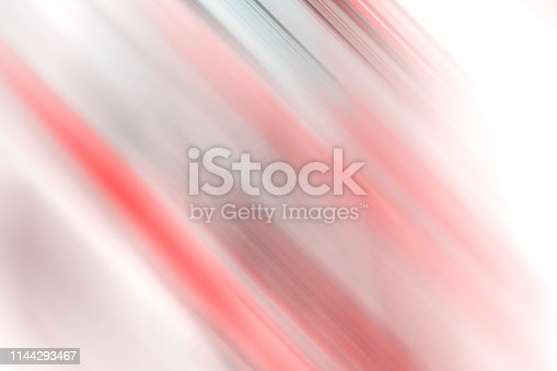 istock Pink and orange blurred stripes and white spotlight colorful background. 1144293467