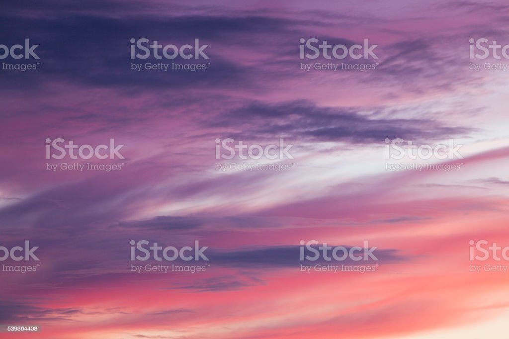 Pink and orange clouds at sunset. stock photo