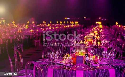 istock Pink and Purple Christmas Decor with candles and lamps for a large party or Gala Dinner 1079456162