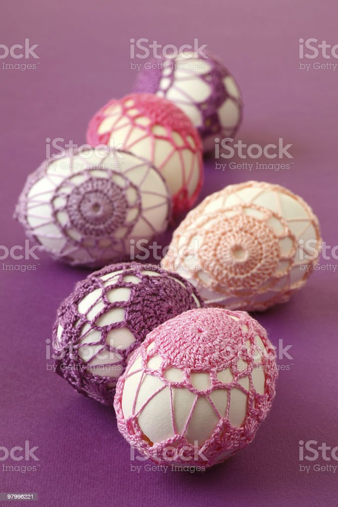Pink and purple crochet Easter eggs royalty-free stock photo