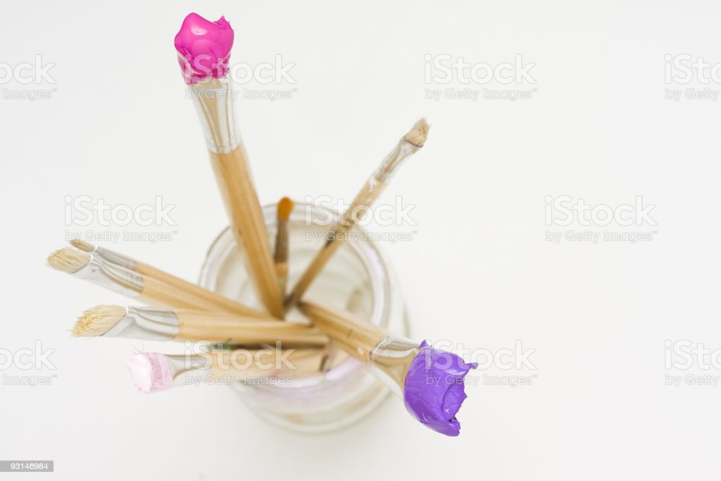 Pink and purple paintbrushes stock photo