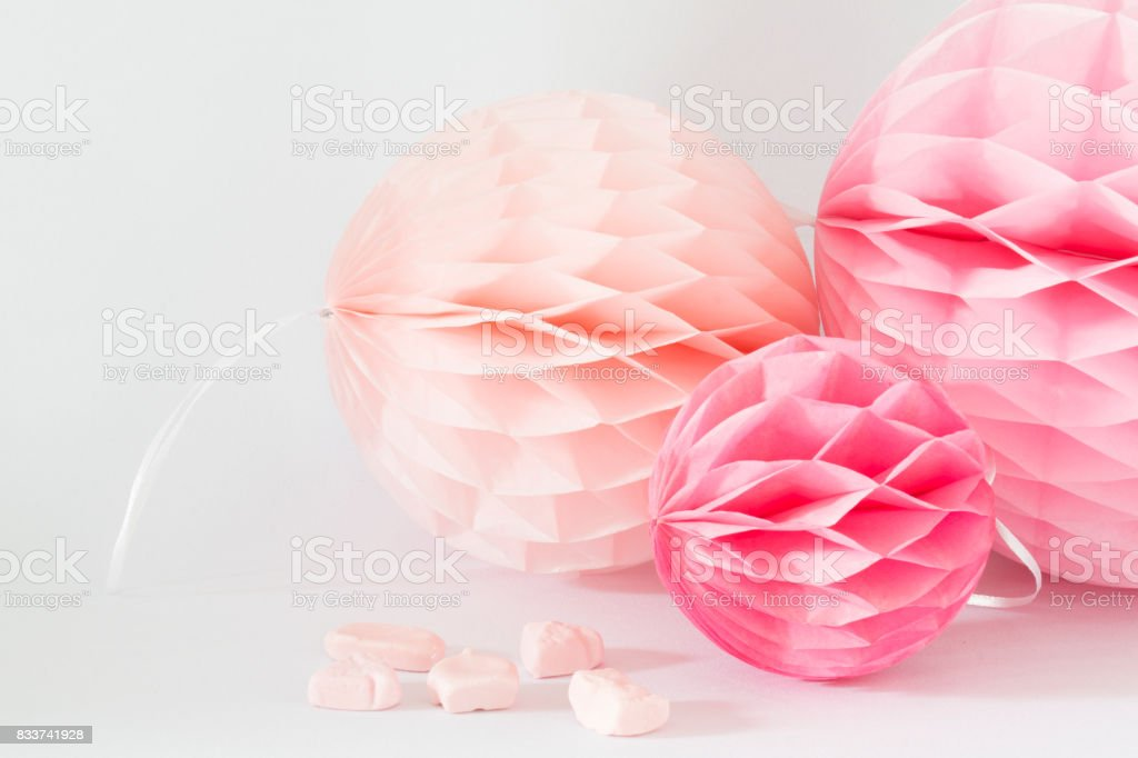 pink and salmon honeycombs with sweet candy against white background stock photo
