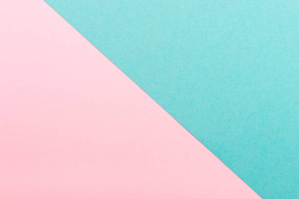 Pink and turquoise color paper texture background. Trend colors, geometric paper background. Colorful of soft paper background.Pastel colors. stock photo