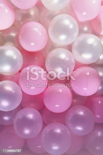 945748362istockphoto Pink and white balls, pastel pink bubbles for beautiful birthday texture background. Top view, flat lay, close up 1128894767
