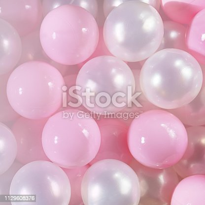 945748362istockphoto Pink and white balls, pastel pink bubbles for beautiful birthday texture background. Top view, flat lay, copy space 1129608376