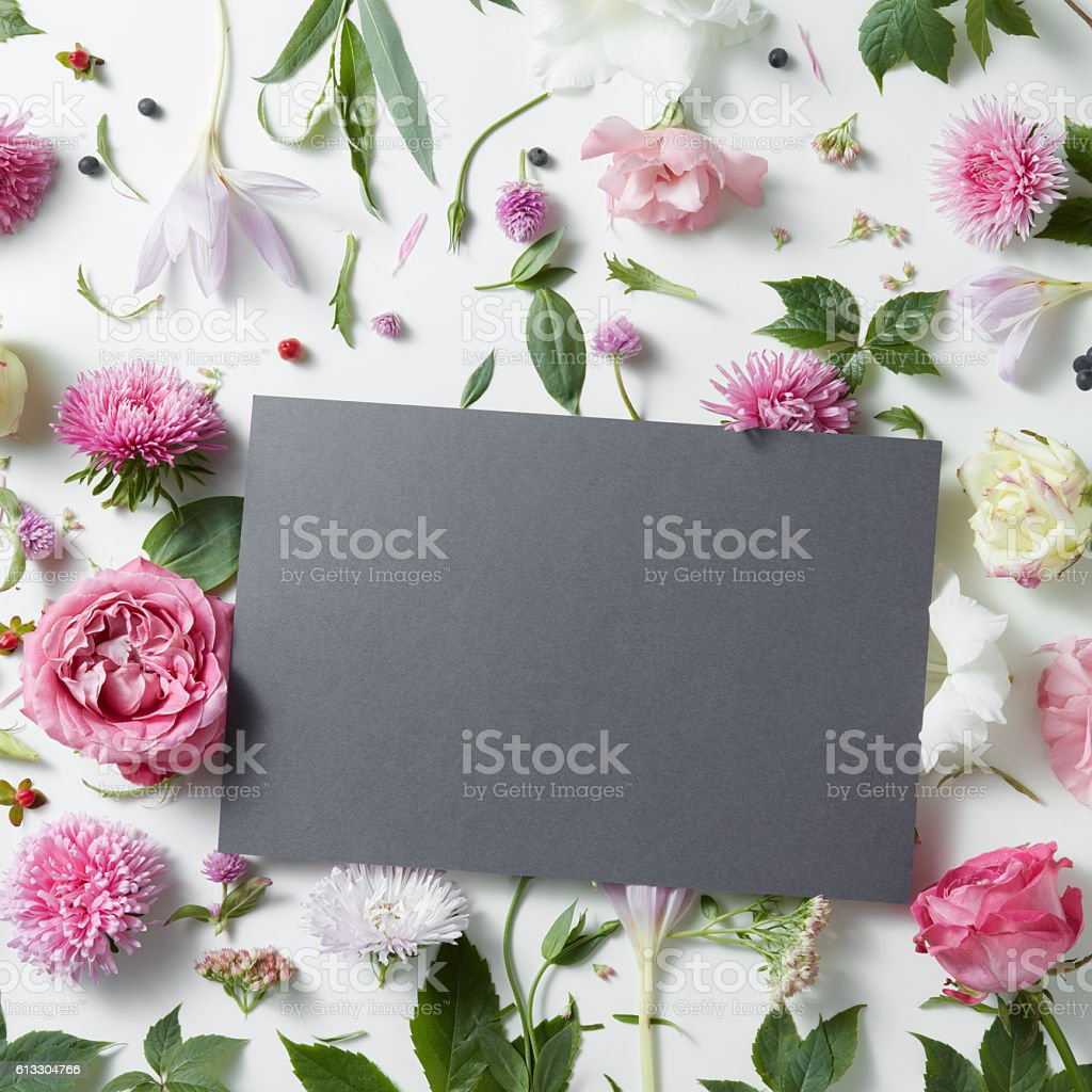 pink and white flowers with empty notebook - foto de stock