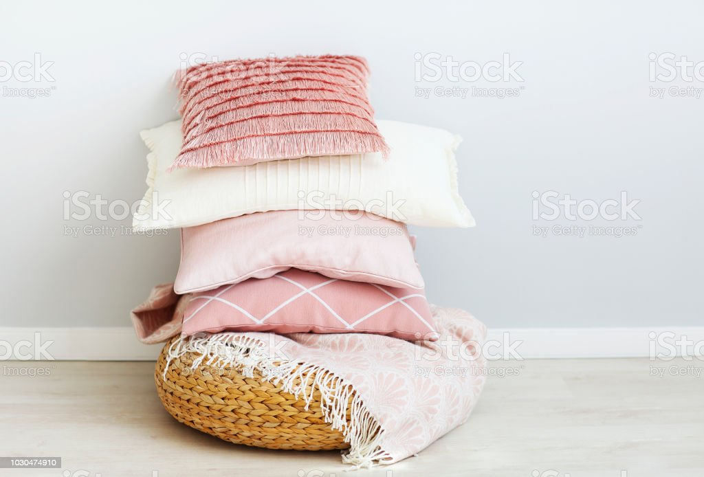 Pink and white pillows on the wall background stock photo