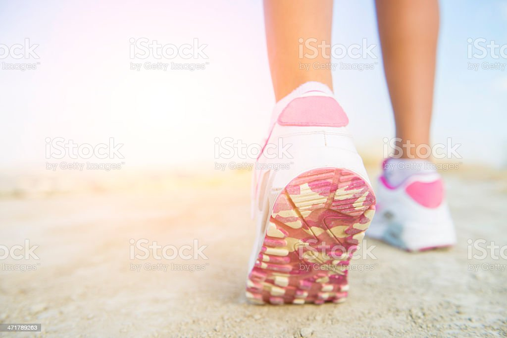 Pink and white soles of walking shoes stock photo