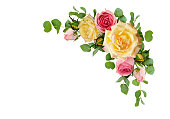 istock Pink and yellow rose flowers with eucalyptus leaves in a corner arrangement 926517744