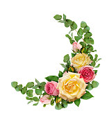 istock Pink and yellow rose flowers with eucalyptus leaves in a corner arrangement 926517746