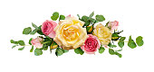 istock Pink and yellow rose flowers with eucalyptus leaves 924716744