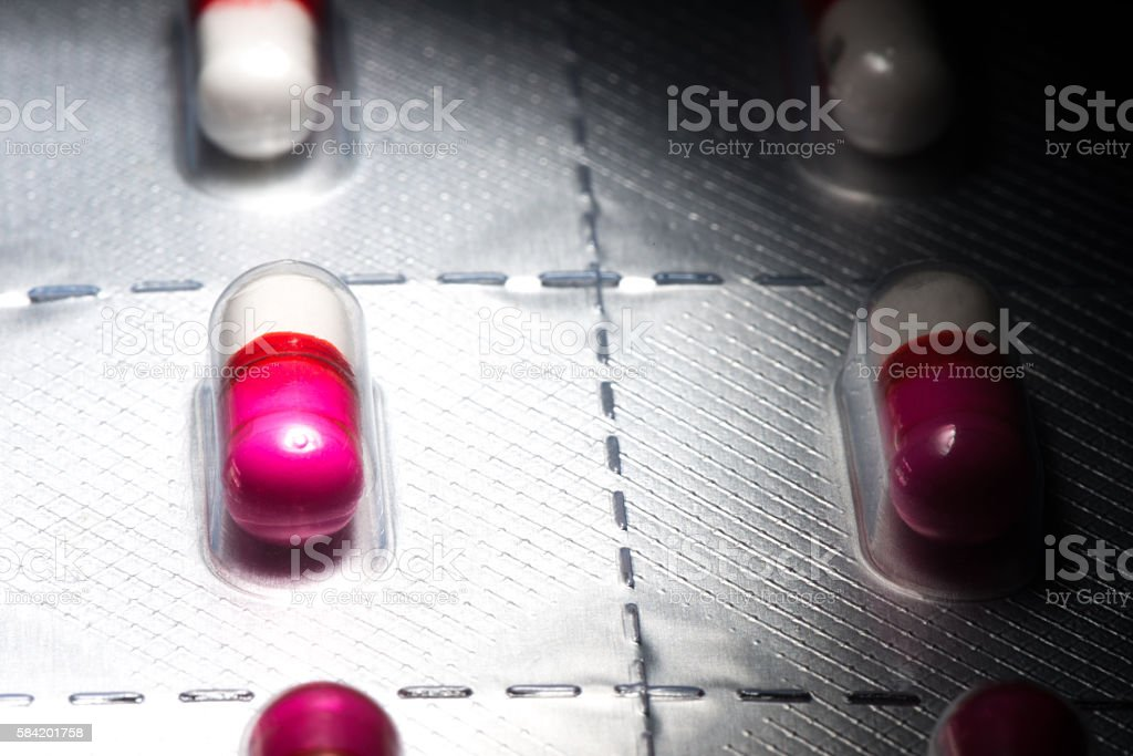 Pink antihistamine capsules in blister pack stock photo
