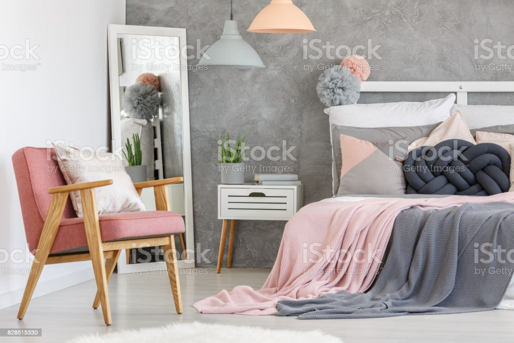 Pink armchair adn mirror stock photo