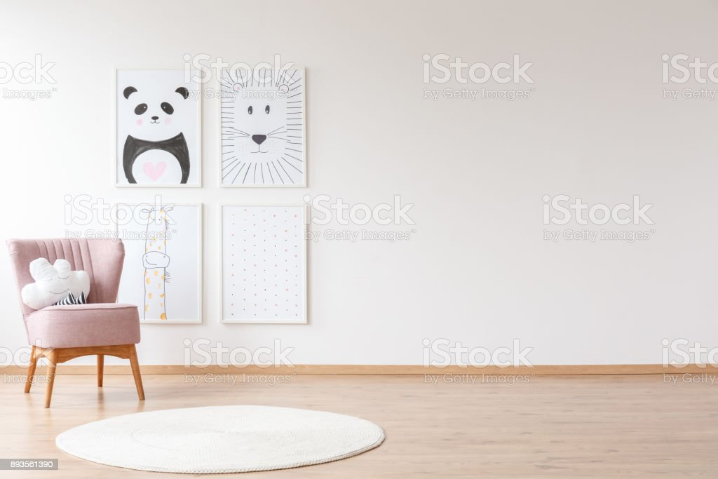 Pink armchair in baby's room stock photo