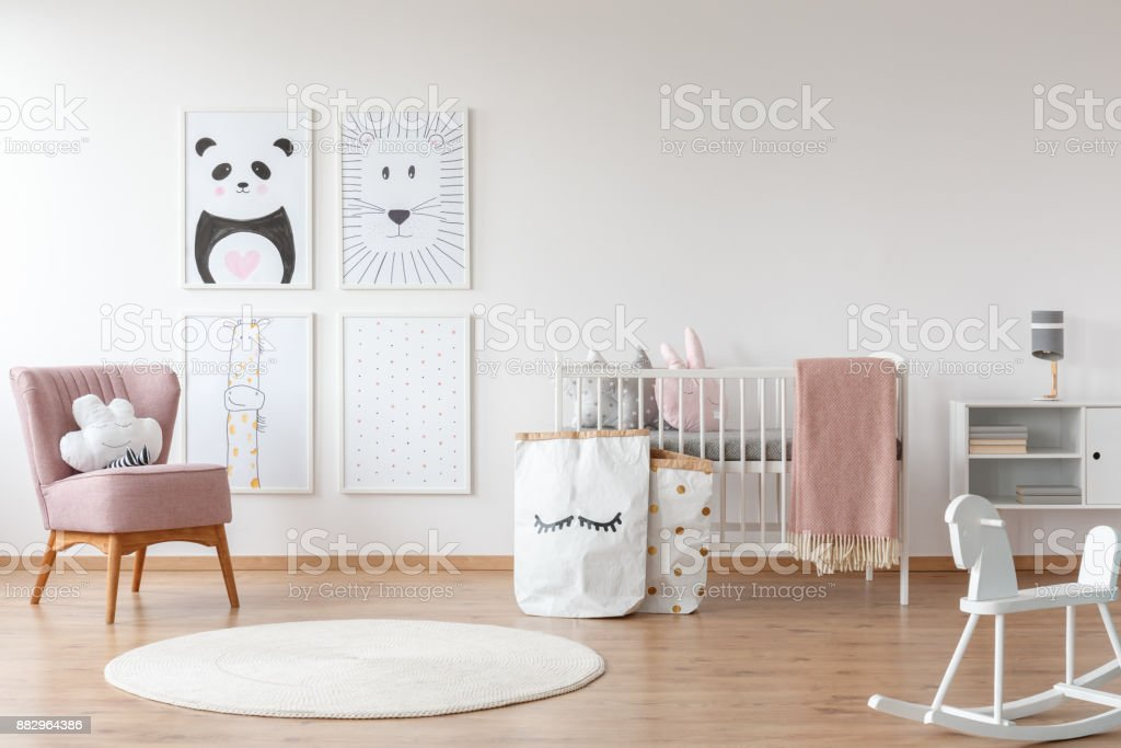 Pink armchair in child's room stock photo