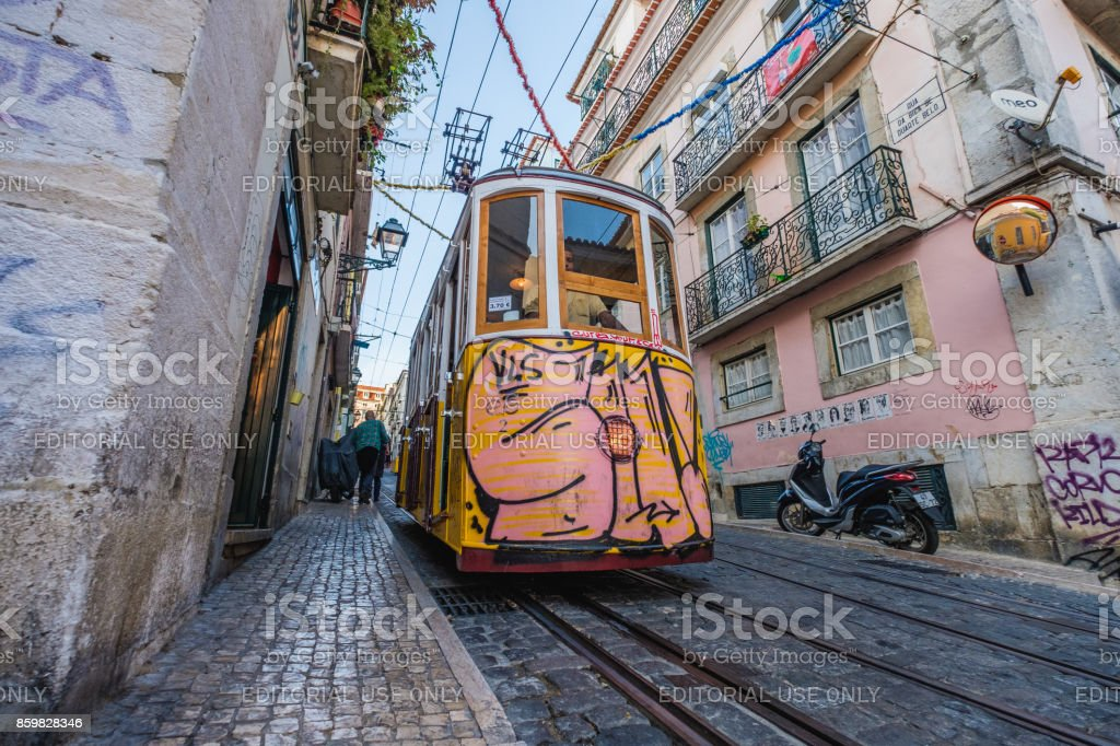 Pink Ascensor da Bica on its way down in Lisbon stock photo
