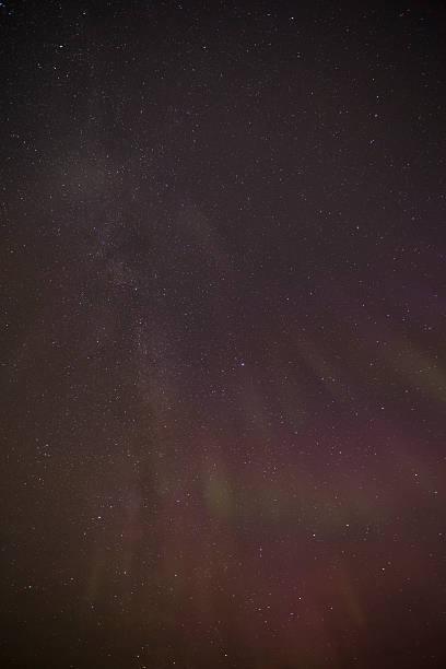 Pink Aurora Borealis with milkyway stock photo