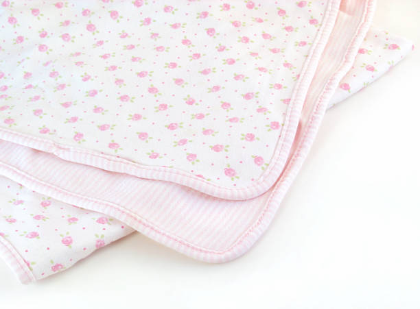 Pink Baby Blanket A pink floral baby blanket on a white background. baby blanket stock pictures, royalty-free photos & images