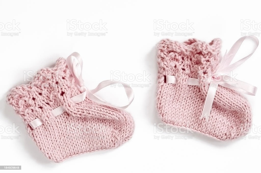 Pink Baby Booties on White Background stock photo