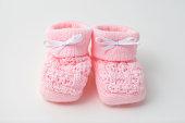 istock Pink baby booties 183894008