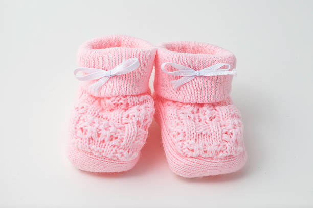 pink baby booties - its a girl stock photos and pictures