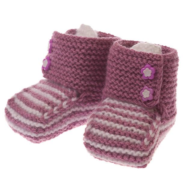 Pink baby booties stock photo
