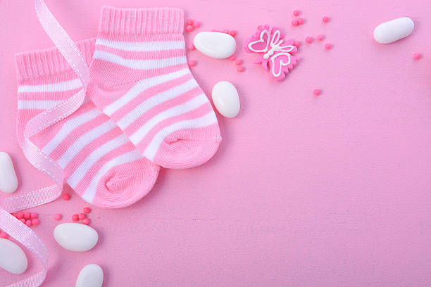 pink baby shower nursery background - its a girl stock photos and pictures