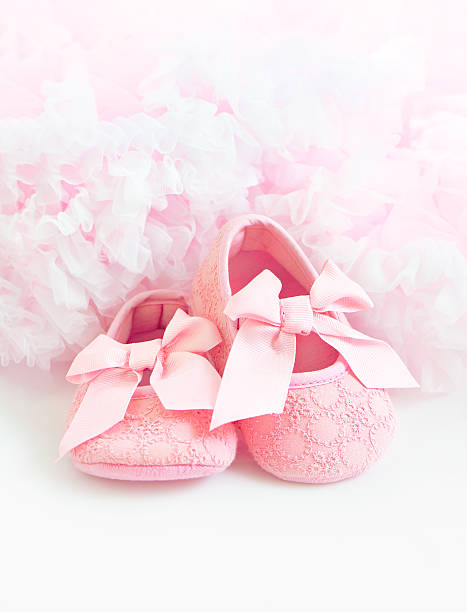 Pink Baby's bootees stock photo