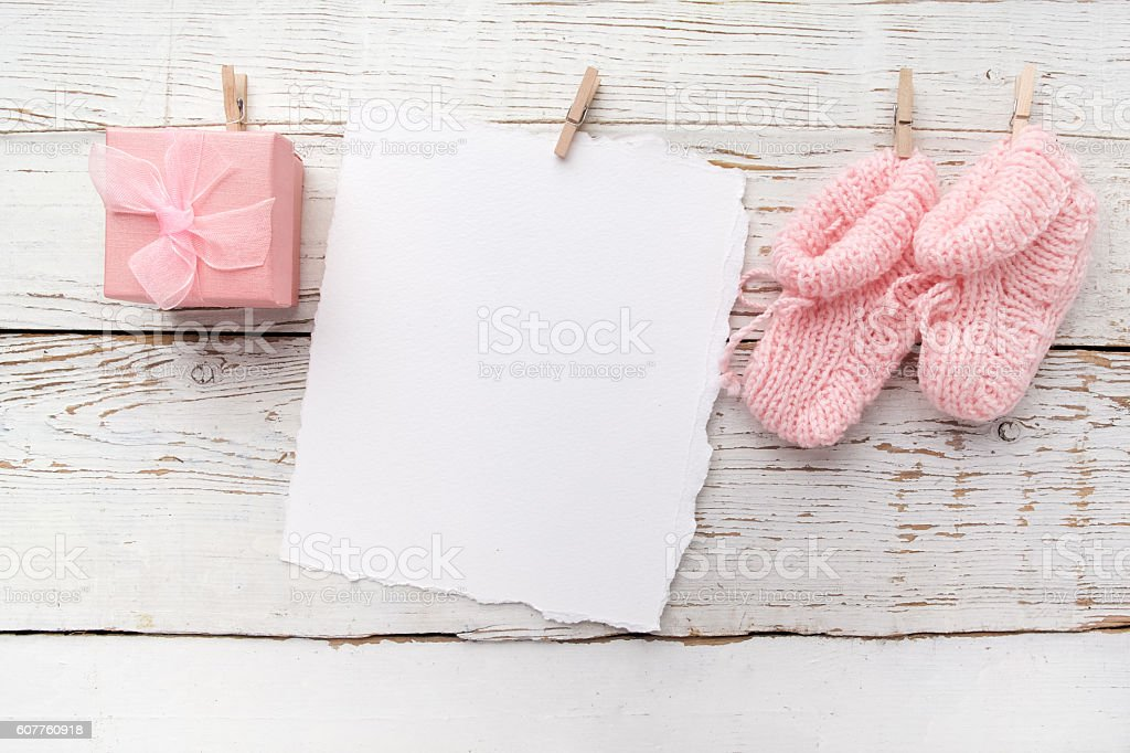 pink baby's booties. Small girls sock and blank card圖像檔