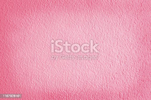 939873258 istock photo Pink background pattern, texture of concrete cement wall with detail of rough stucco for and design art work. 1167928161