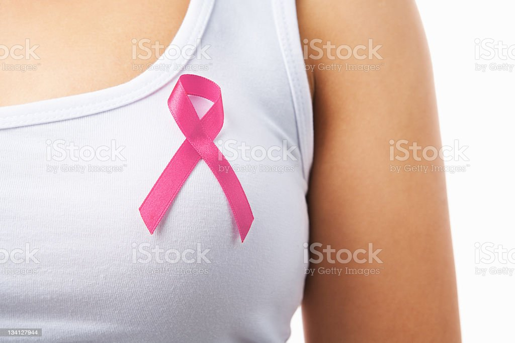 Pink badge on woman chest to support breat cancer cause stock photo