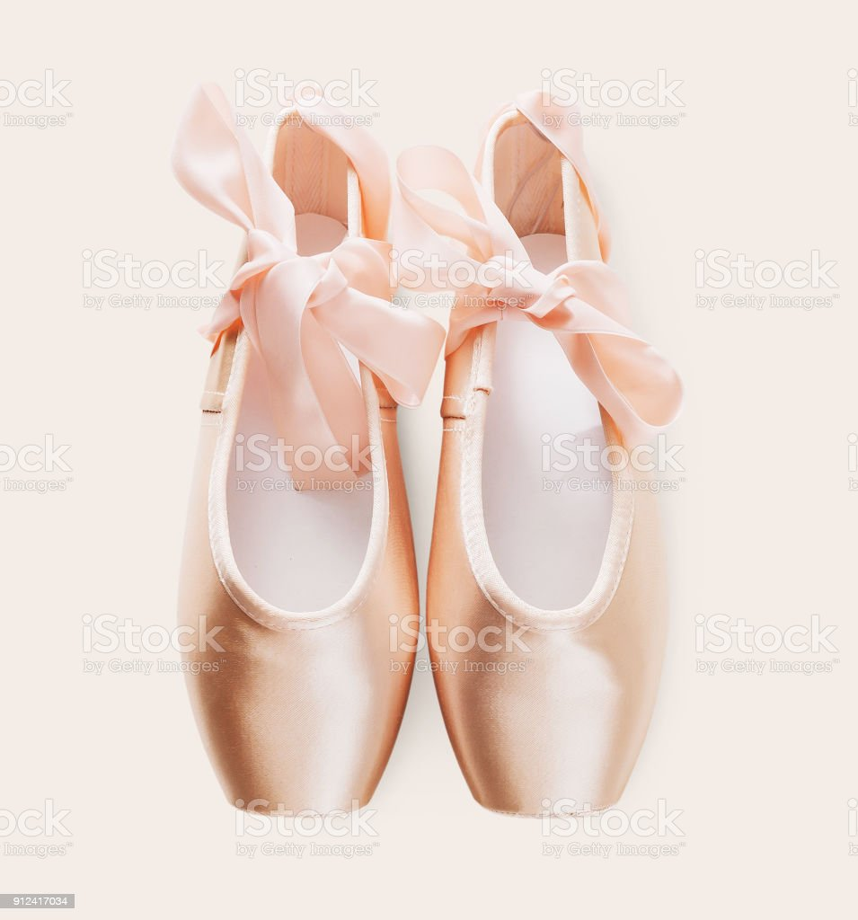 Pink ballet pointe shoes on white isolated background stock photo
