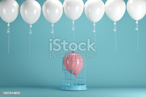 903520476 istock photo Pink balloon floating in white cage on blue background with white balloons. minimal idea concept. 1002544820