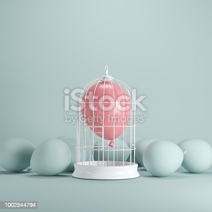 903520476 istock photo Pink balloon floating in white cage on pastel green background. minimal idea concept. 1002544794