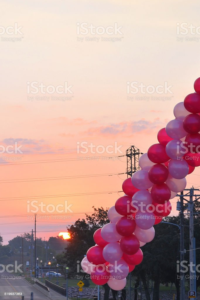 Pink Balloons At Sunrise stock photo