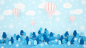 Pink balloons , forest and snowflake on the sky background. Artwork for balloon international festival. paper cut or craft style.Winter season artwork.3D illustration.