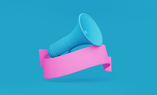 istock Pink Banner and Teal Megaphone over Teal Background 1194396989