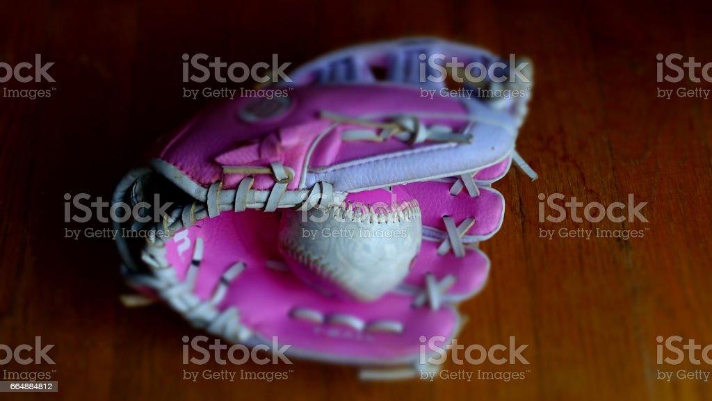 pink baseball glove and baseball stock photo
